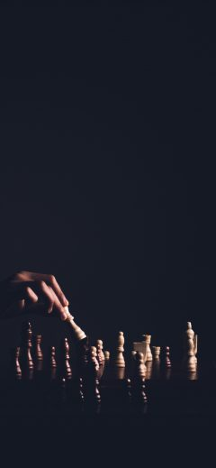 Hand playing chess background
